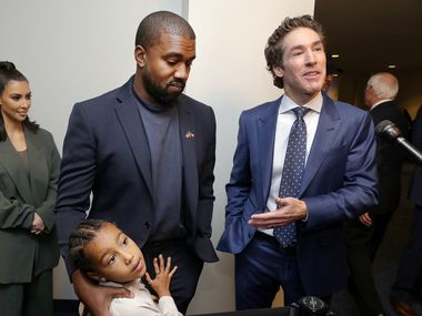 From left, Kim Kardashian West, North West, Kanye West and Joel Osteen answer questions after the 11 a.m. service at Lakewood Church, Sunday, Nov. 17, 2019, in Houston.
