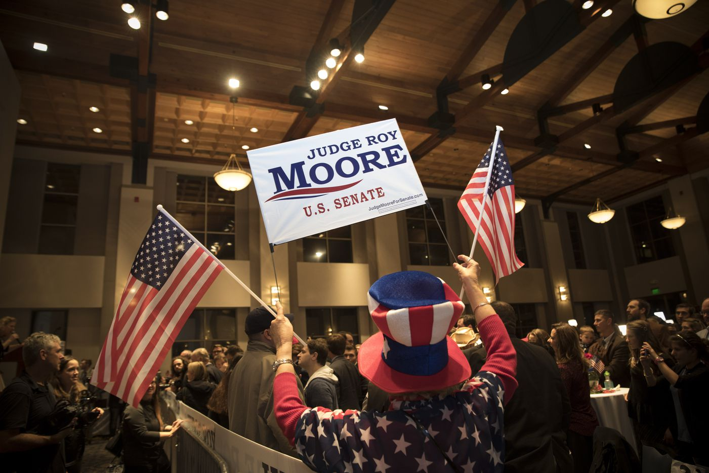 A supporter of Roy Moore, the Republican candidate for U.S. Senate, at an election-night party in Montgomery, Ala., Dec. 12, 2017. Alabama voters went to the polls Tuesday to decide between Roy Moore, a Republican, and Doug Jones, a Democrat, in a special Senate election destined to be remembered as a strange and ugly campaign carrying immense political implications. (Audra Melton/The New York Times)