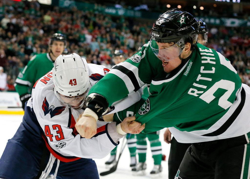 Dallas Stars' Brett Ritchie (25) bleeds on his mask after being punched in the face by Washington Capitals' Tom Wilson (43) in the first period an NHL hockey game, Saturday, Jan. 21, 2017, in Dallas. (AP Photo/Tony Gutierrez)