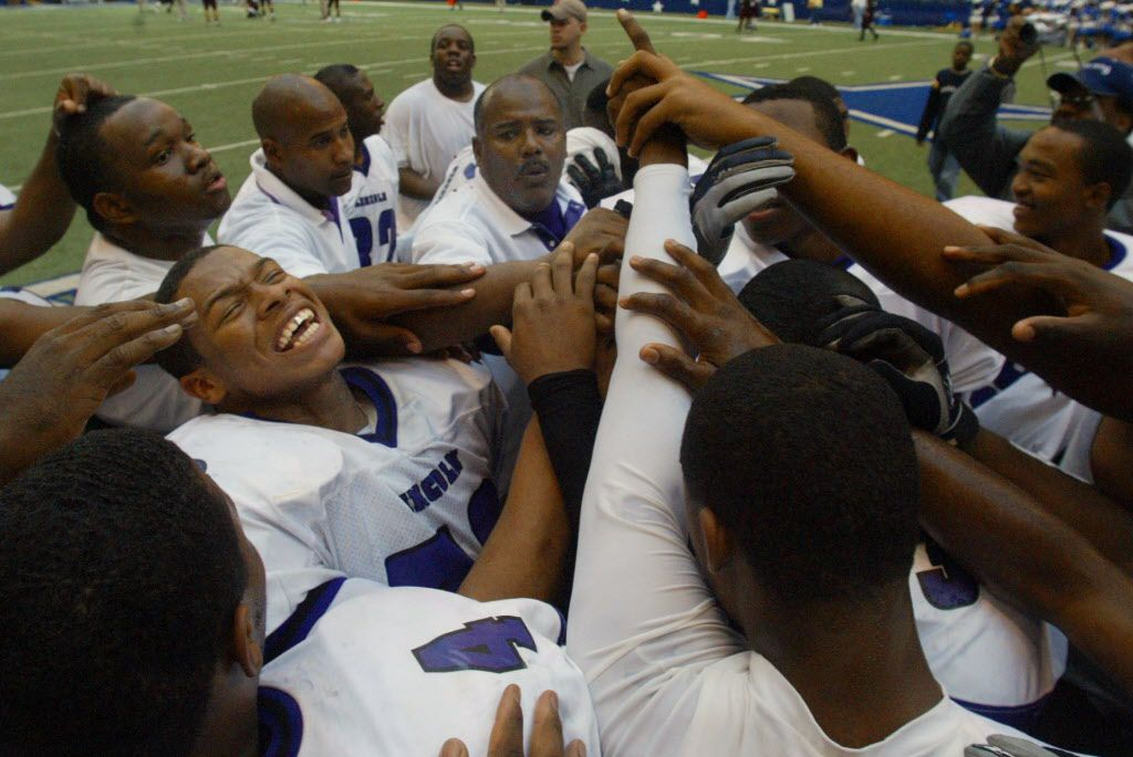 11/26/04 --   Lincoln's #32 Jerrode Sneed, left, does a chant as the team and head coach Reginald Samples, center, listen as they celebrated their win over Corsicana's in the Class 4A Division II Region II semifinal football game at Texas Stadium on Friday, Nov. 26, 2004 in Irving.