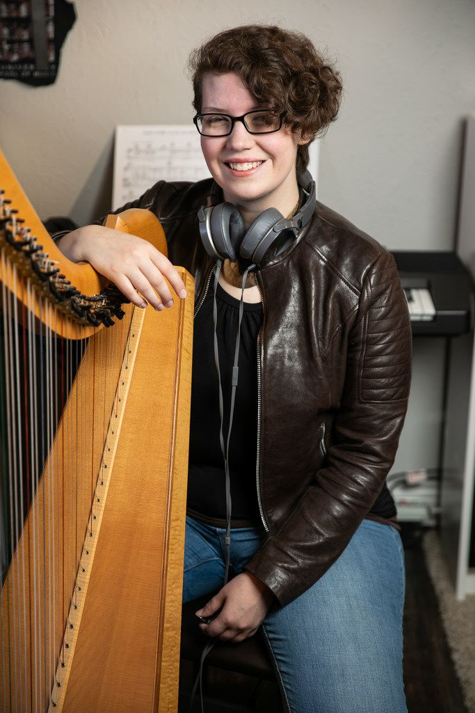 Portrait of Kimberley Osberg with her harp at her Dallas home.