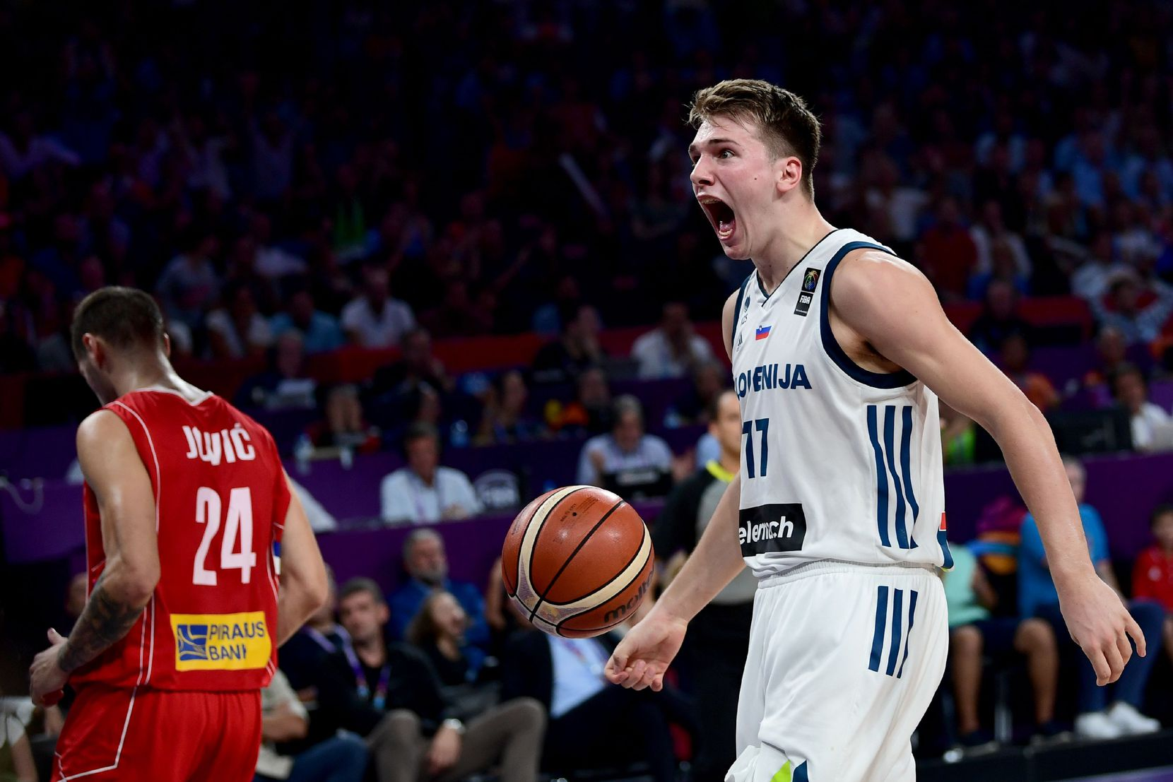 FILE - Slovenia guard Luka Doncic (right) is pictured during the 2017 FIBA EuroBasket men's final between Slovenia and Serbia at Sinan Erdem Sport Arena in Istanbul on Sept. 17, 2017. (OZAN KOSE/AFP PHOTO/Getty Images)