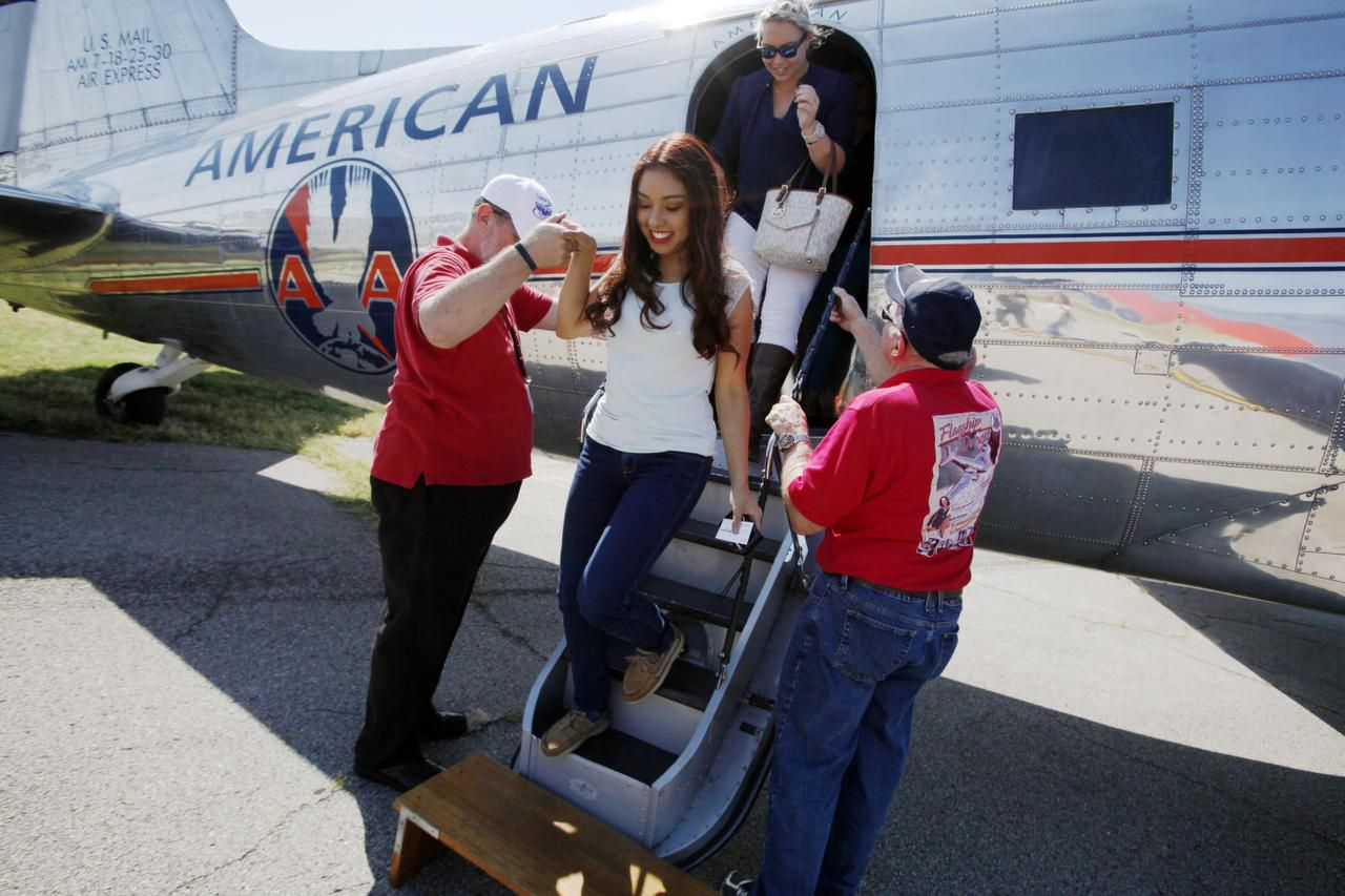 Sofia Corona, 17, got a hand as she stepped off the Flagship Detroit, a restored American Airlines DC-3, after she and a group of middle and high school girls took a flight over Dallas to promote Girls in Aviation Day.