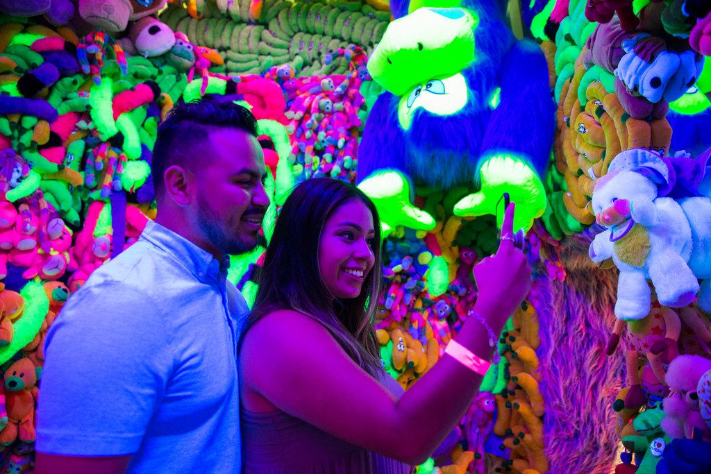 Karen Nino takes a selfie with Brian Rosas at the Sweet Tooth Hotel art installation in July