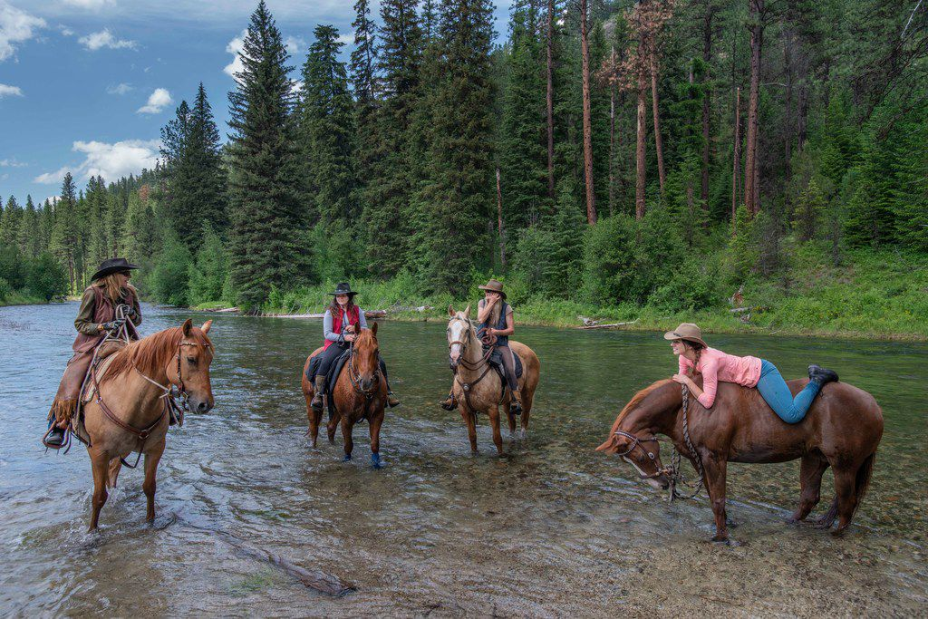 Horseback riders hit the trail — and the river — near the Minam River Lodge.