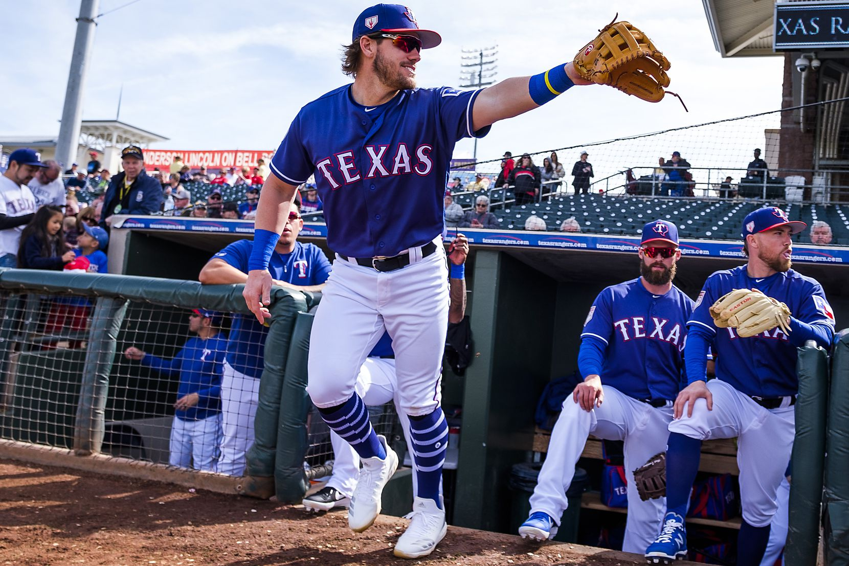 Texas Rangers infielder Patrick Wisdom takes the field for a spring training game against the Milwaukee Brewers on Feb. 24 at Surprise Stadium in Surprise, Ariz.