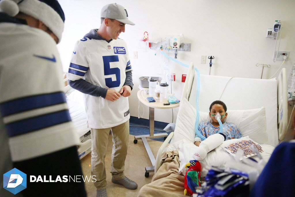 Dallas Cowboys kicker Dan Bailey speaks with Xavier Sanford, 9, f Dallas, during a visit to Medical City. Children's Hospital in Dallas Monday December 5, 2016. Players, who were joined by the Dallas Cowboys Cheerleaders, brought gifts for patients and signed their autographs.