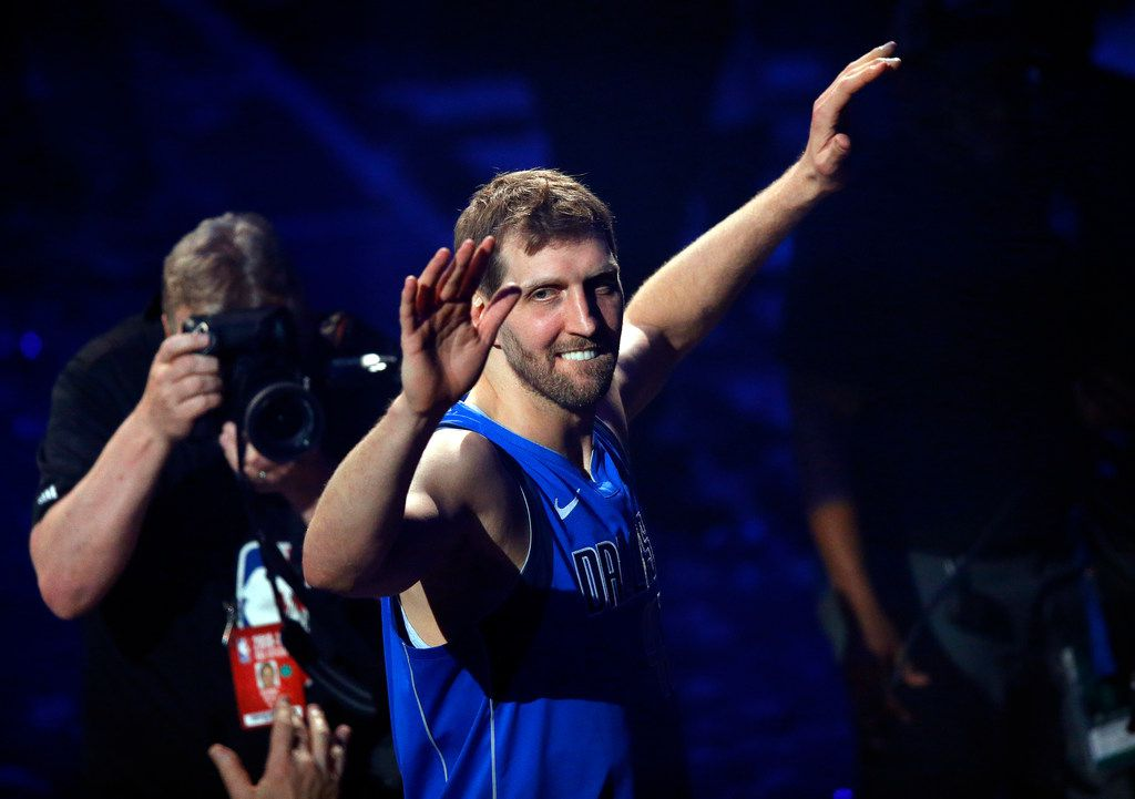 Dallas Mavericks forward Dirk Nowitzki waves to fans as he leaves the court following a post-game ceremony at American Airlines Center in Dallas on Tuesday, April 9, 2019.  (Tom Fox/The Dallas Morning News)