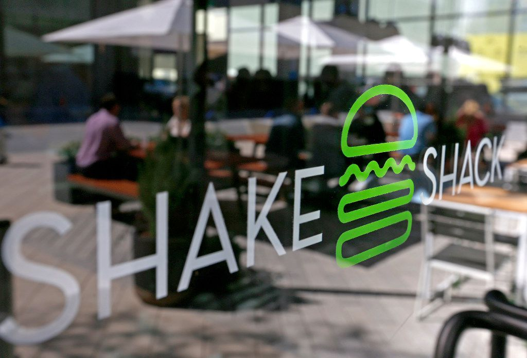 Diners are reflected in the door of Shake Shack that opens its store in the mixed-use Legacy West development in Plano, Texas, Wednesday, March 29, 2017. (Jae S. Lee/The Dallas Morning News)