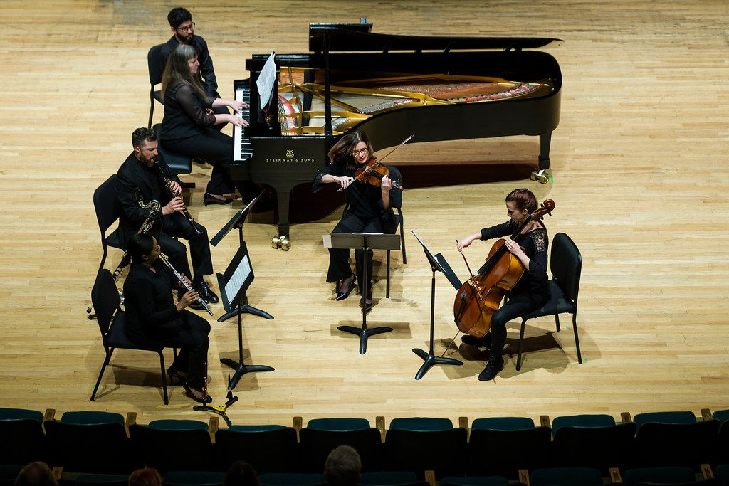Clockwise from bottom left: Ebonee Thomas (flute), Stephen Ahearn (clarinet), Liudmila Georgievskaya (piano), Maria Schleuning (violin) and Hannah Thomas-Hollands (cello) perform Static by Sebastian Currier during a concert by Voices of Change at SMU's Caruth Auditorium on May 6, 2019, in Dallas.