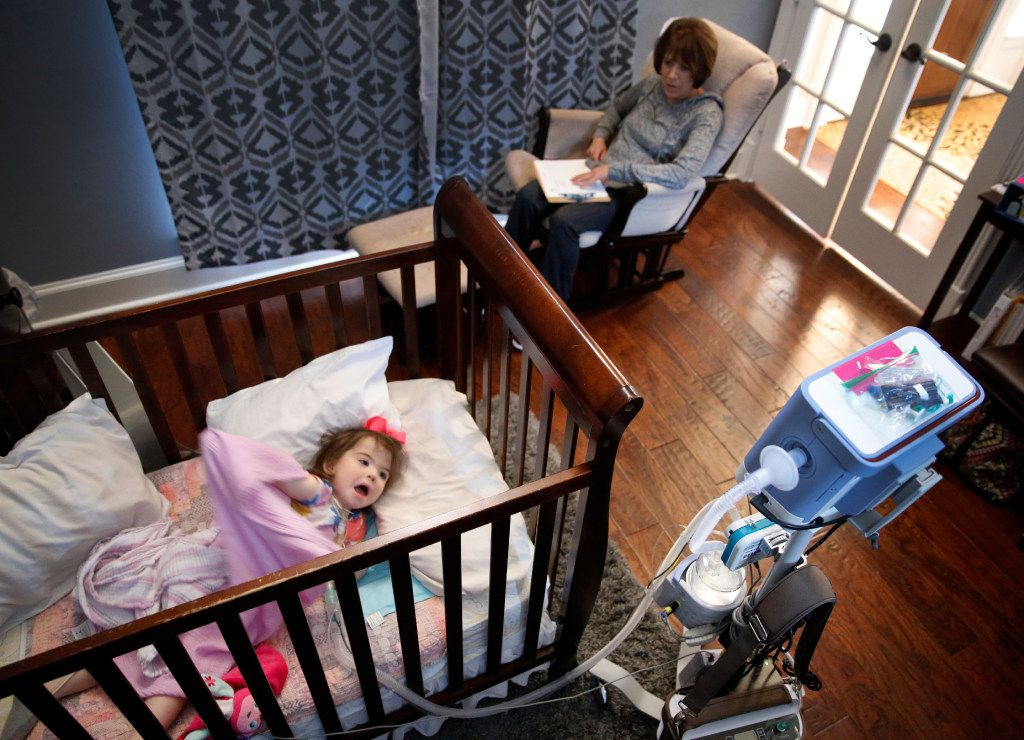 Home health pediatric nurse Audrey Jakubowski keeps a watchful eye on 2 year-old Christina Gregory as she calms down before taking a nap. The Gregory's have two pediatric nurses that work around the clock to ensure Christina doesn't stop breathing at their Southlake,Texas home, Tuesday, January 31, 2017. Christina suffers from CCHS (Congenital Central Hypoventilation Syndrome), a genetic disorder that affects her breathing. The Gregorys are affected by Texas' change to their Medicare healthcare coverage, switching to a MCO plan from an HMO plan, limiting their care to within the region -a cumbersome issue for families dealing with 24/7 care. (Tom Fox/The Dallas Morning News)