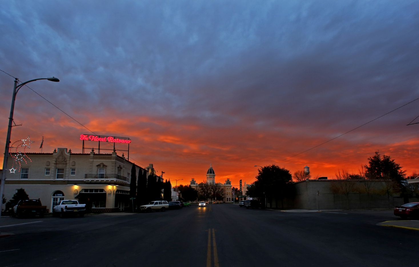 The sun sets over The Hotel Paisano and the courthouse in Marfa on Dec. 7, 2016.