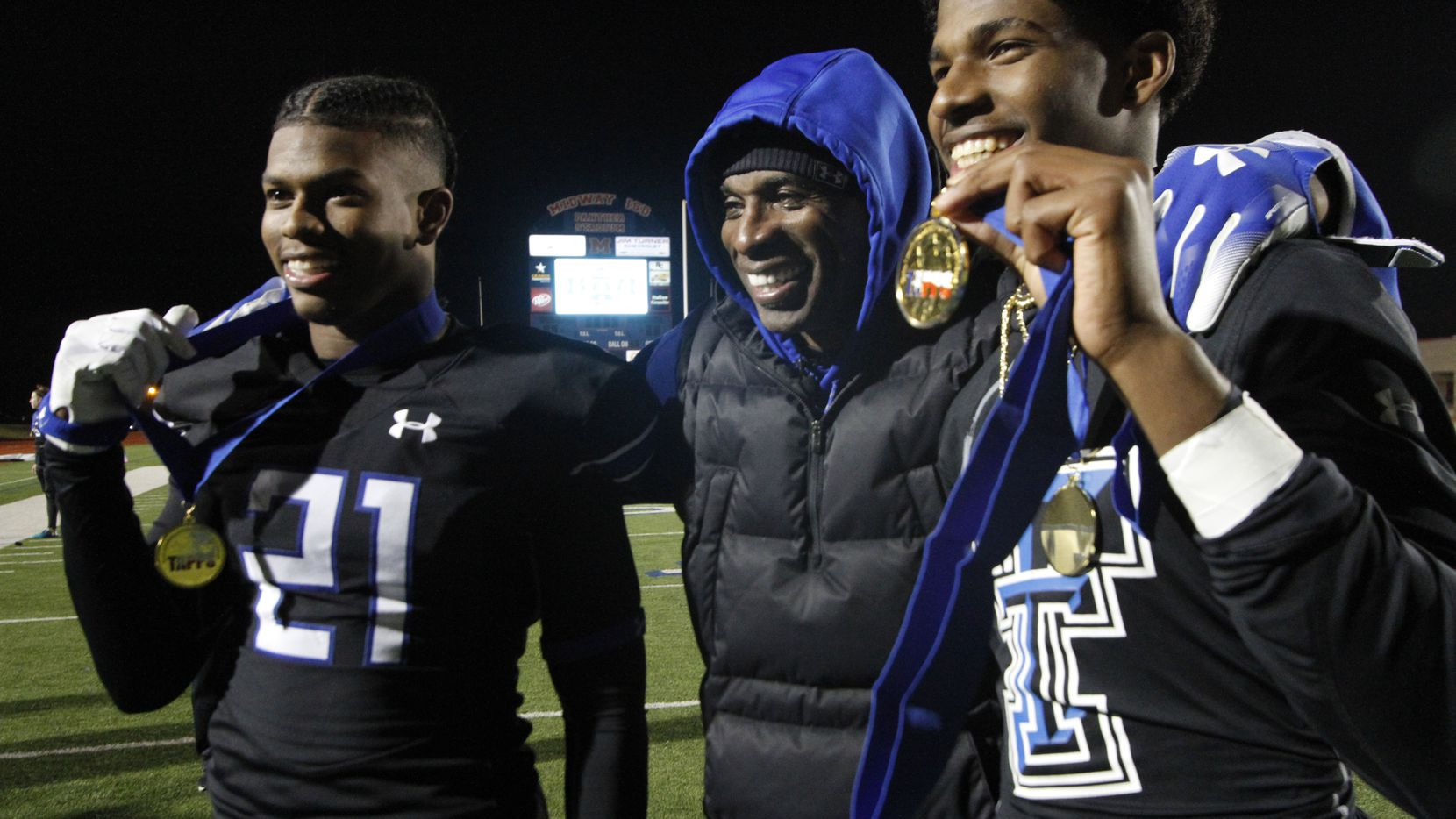 TC-Cedar Hill assistant coach Deion Sanders poses with his sons Shilo Sanders (21) and Shedeur Sanders (2) as the trio celebrate the team's 49-24 victory over Austin Regents to claim the state championship trophy and medals. The TAPPS Division ll state championship game between Trinity Christian-Cedar Hill and Austin Regents was played at Waco Midway Stadium in Waco on December 8, 2018.  (Steve Hamm/ Special Contributor)