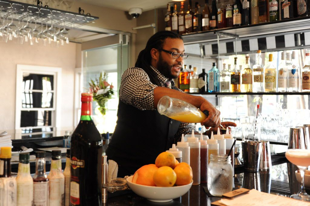 Bartender Thomas Holbert mixes a cocktail at Pink Magnolia in Oak Cliff.