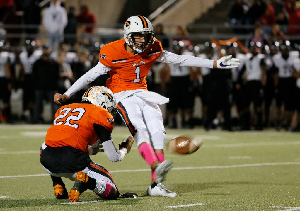Haltom field goal kicker Hunter Villavicencio (1) kicks a field goal from holder Johnny Smith-Rider (22) against Euless Trinity during the second half of their high school football game on Oct. 11, 2019 in North Richland Hills. Haltom defeated Trinity 23-20. (Michael Ainsworth/Special Contributor)