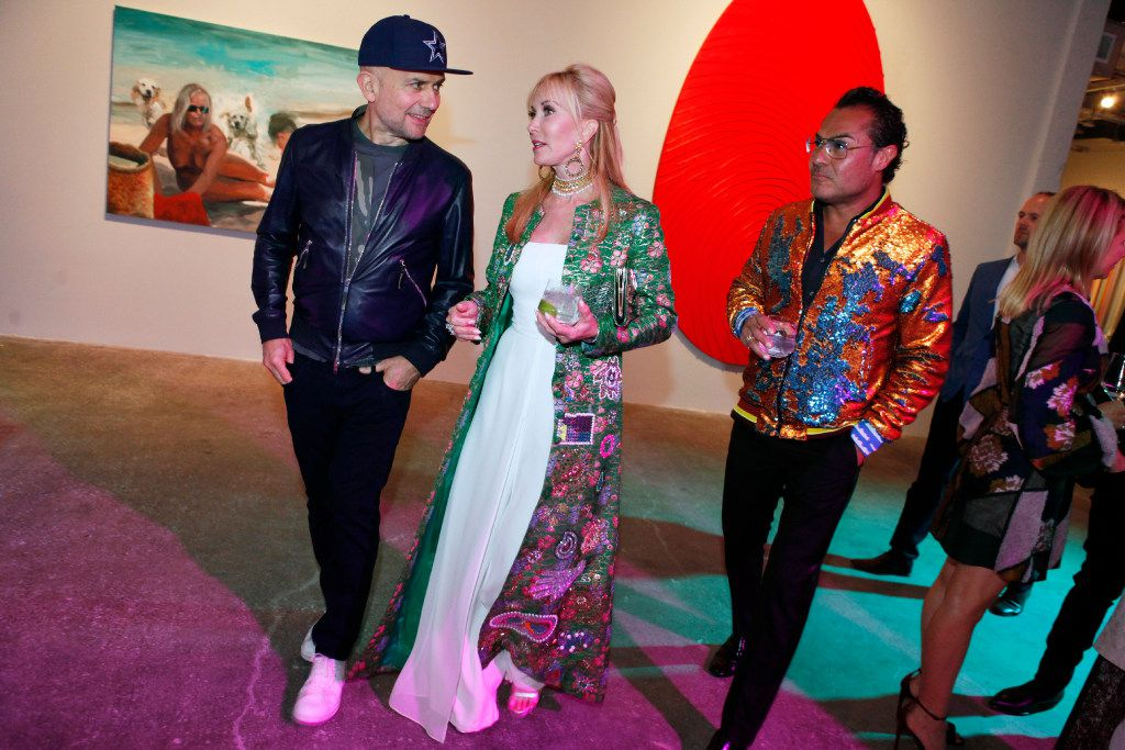 Artist Marc Quinn, left, walks with Nancy Rogers, wife of Richard Rogers (not pictured), son of Mary Kay Ash, and hair stylist Michael Flores, right, during the MTV RE:DEFINE gala at the Dallas Contemporary, Friday evening, March 24, 2017 in Dallas. Ben Torres/Special Contributor