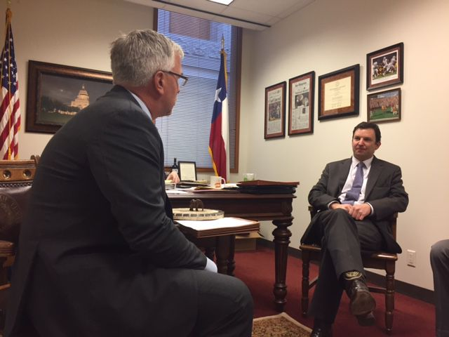 Badger (left) talks roofing with State Rep. Craig Goldman, R-Fort Worth in Goldman's office.