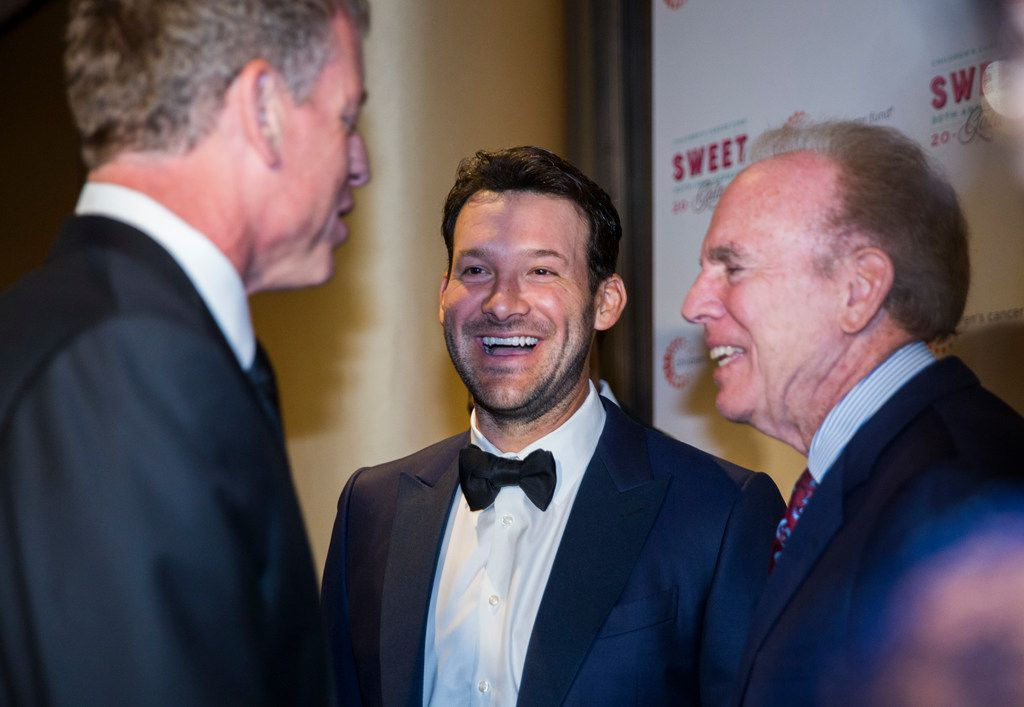 FILE - Former Dallas Cowboys quarterbacks Troy Aikman, Tony Romo and Roger Staubach laugh together during The Children's Cancer Fund Gala on Friday, April 27, 2018 at Hyatt Regency Dallas. (Ashley Landis/The Dallas Morning News)