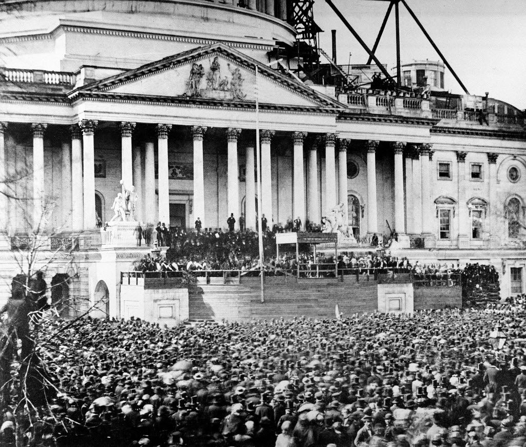 """In this March 4, 1861, file photo, U.S. President Abraham Lincoln stands under cover at center of Capitol steps during his inauguration. He passionately made the case against a civil war: """"We are not enemies, but friends. We must not be enemies."""""""