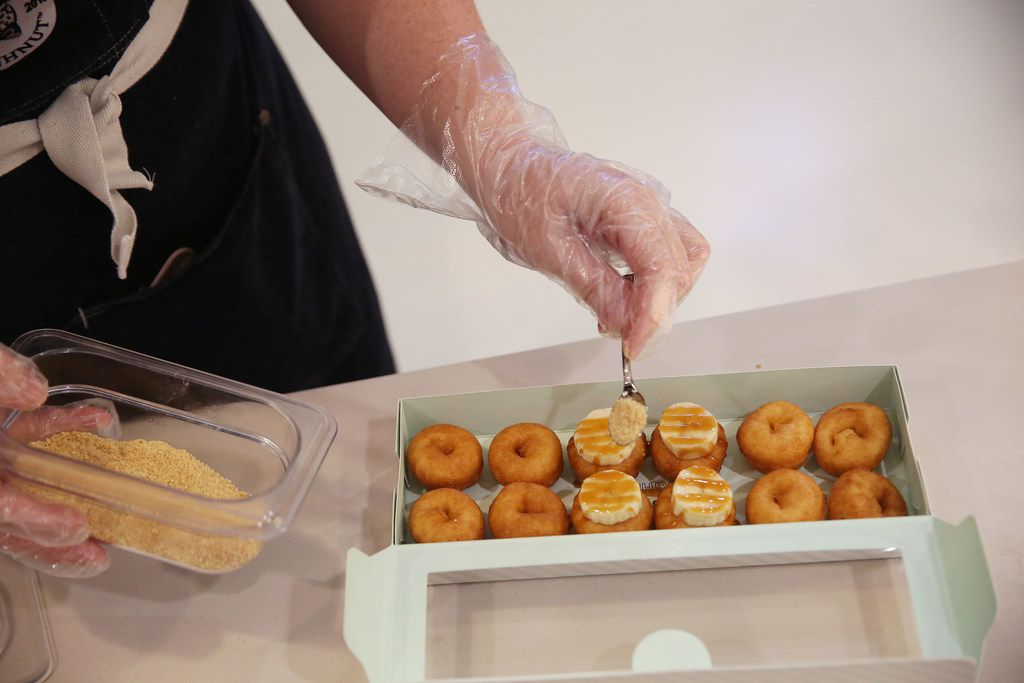 Brooke Sanchez prepares Banana Foster doughnuts at The Dapper Doughnut.