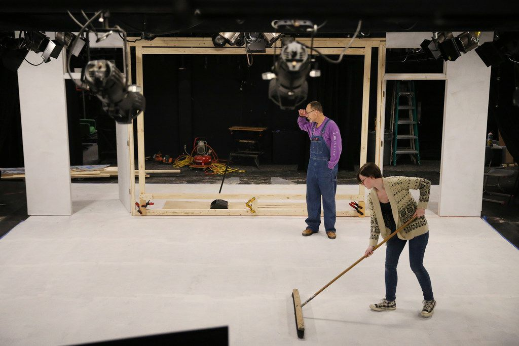 Jeff Mizener (back), assistant master carpenter and technical consultant, looks at the set as Madeleine Morris, stage manager, sweeps before a rehearsal of Glengarry Glen Ross at the Bath House Cultural Center in Dallas on Dec. 4.