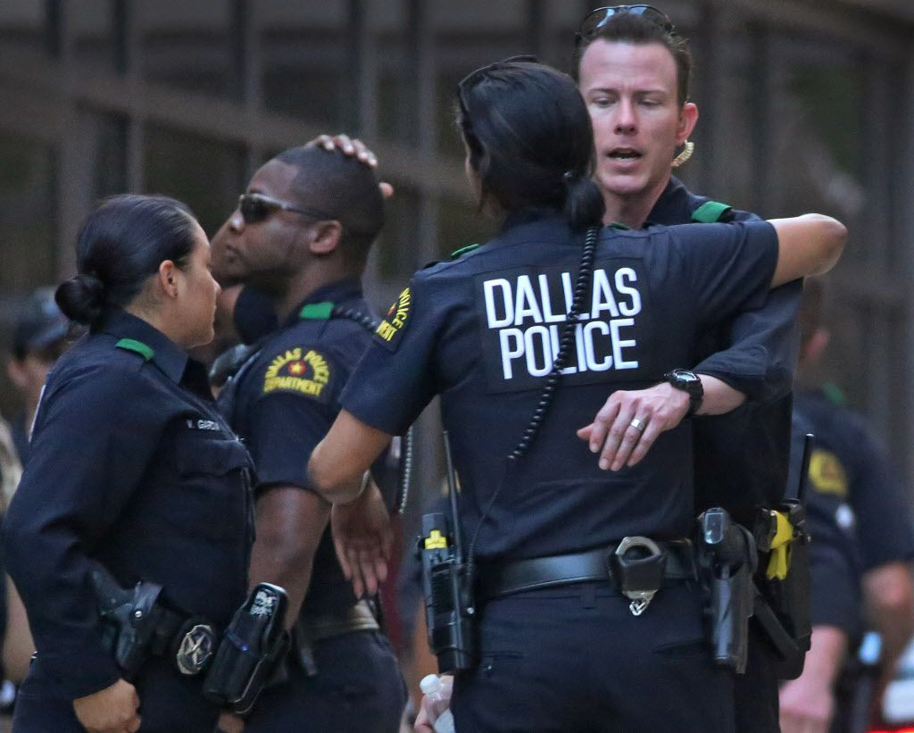 Dallas Police officers outside the emergency room at Presbyterian Hospital in Dallas.
