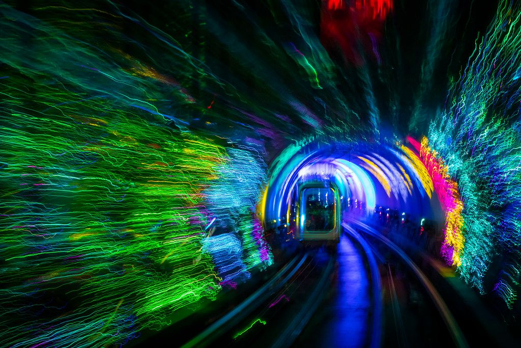 Automated trams cross under the Huangpu River  through the colorful lights of the Bund Sightseeing Tunnel on Saturday, Oct. 6, 2018, in Shanghai. (Smiley N. Pool/The Dallas Morning News)