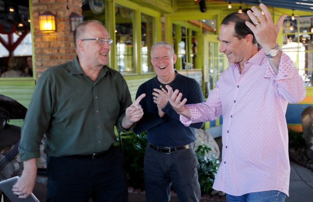 Randall White, left, and Jeff Herrington, center, celebrate early vote returns with incumbent Dallas City Council member, place 11, Lee Kleinman at Mattito's in Dallas, Saturday, May 6, 2017.