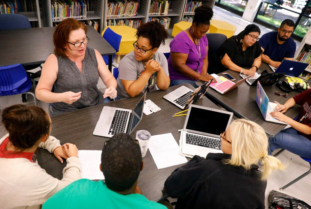Tamara Coalson (top left) leads a discussion among teachers participating in a Professional Learning Community, a collaborative meeting where they can share ideas and experiences, at Richardson ISD's Aikin Elementary in Dallas on June 28, 2019.