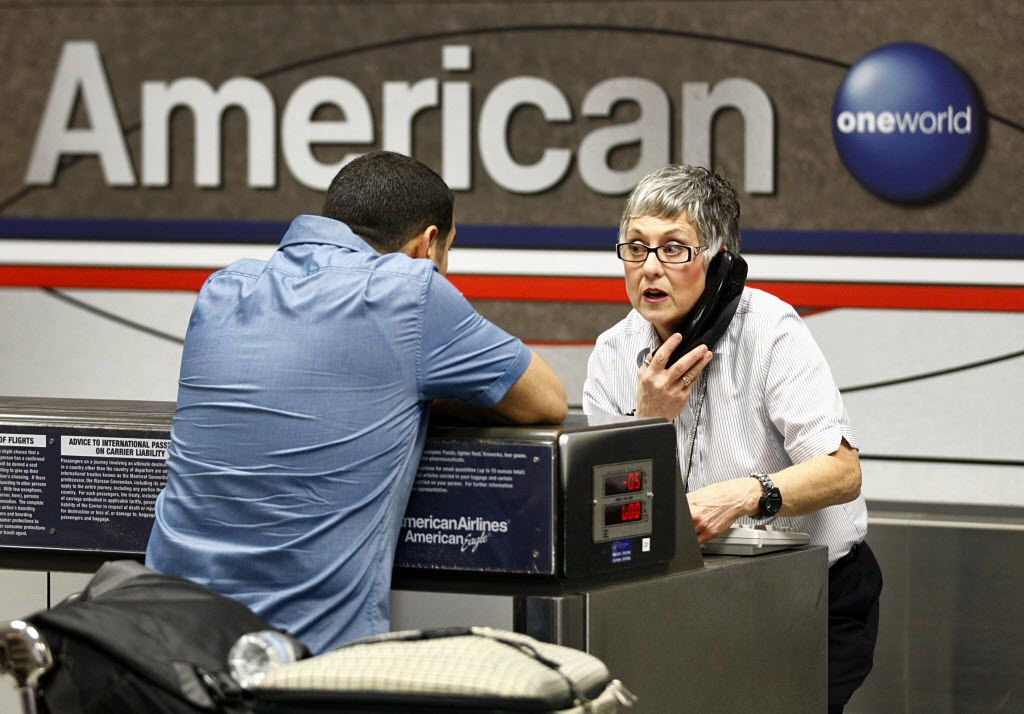American Airlines agent Catherine Christensen patiently helped a passenger with his flight arrangements from DFW International Airport in 2013.