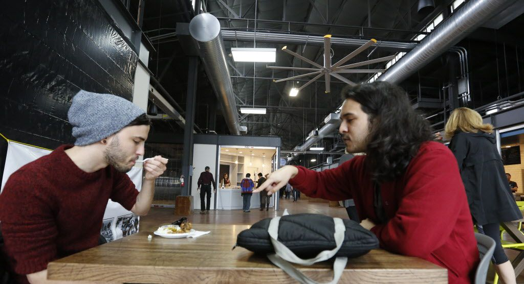 Alvaro Ramalho, left. and Sergio Espinosa sample food from The Caribbean Cabana during The Market's soft opening at the Dallas Farmers Market Friday December 11, 2015.  (Ron Baselice/The Dallas Morning News)   [ This is located in the building formerly called Shed 2 at the Dallas Farmers Market ]