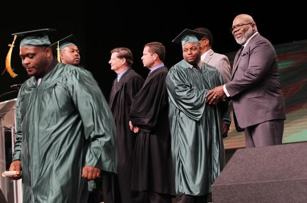 Bishop T.D. Jakes (right) congratulates graduates of his Texas Offenders Re-entry Initiative at commencement.