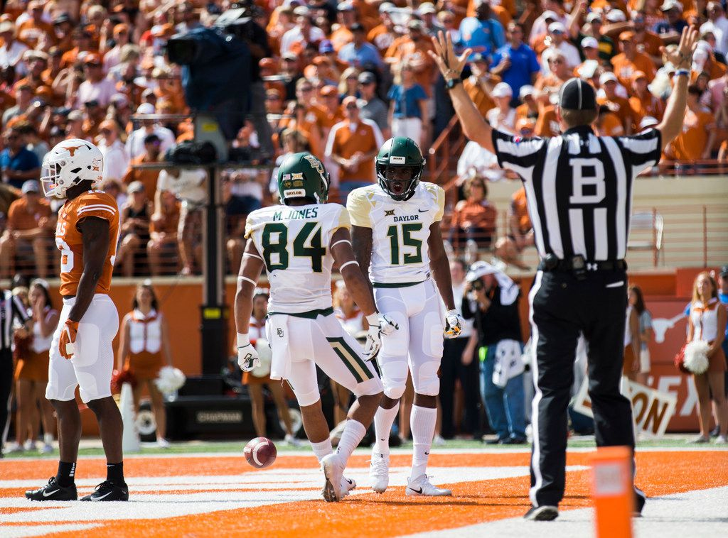 Baylor Bears wide receiver Denzel Mims (15) celebrates a touchdown with wide receiver Marques Jones (84) during the first quarter of a college football game between Baylor and the University of Texas on Saturday, October 13, 2018 at Darrell K Royal Memorial Stadium in Austin, Texas.  (Ashley Landis/The Dallas Morning News)