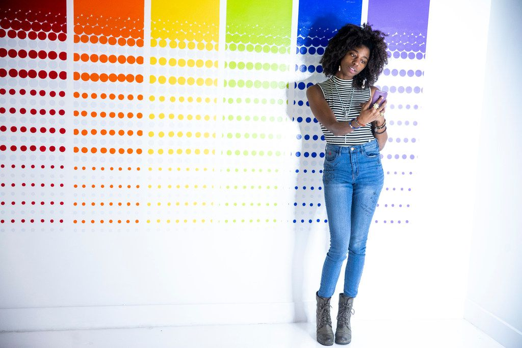 Chynna Oliver takes a photograph in front of a wall during a soft opening night at Rainbow Vomit on Thursday, Jan. 17, 2019. Rainbow Vomit is a new immersive art installation that will open on Saturday, January 19, 2019. (Shaban Athuman/The Dallas Morning News)