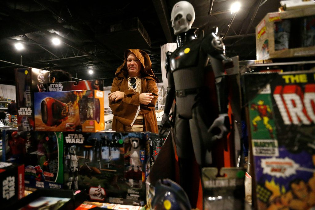 Tommy Raye, dressed as a Jedi, stands behind his booth during North Dallas Toy Show at Dallas Event Center in Farmers Branch, Texas, Saturday, Jan. 6, 2018.