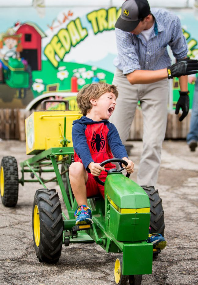 Carson Barter, 5, of Dallas, competes in the Pedal Tractor Pull during the State Fair of Texas at Fair Park on Friday, Oct. 14, 2016, in Dallas. (Smiley N. Pool/The Dallas Morning News)