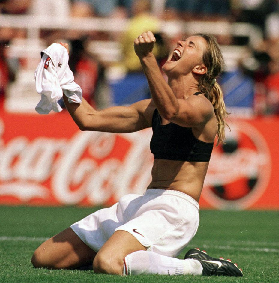 The United States' Brandi Chastain celebrates by taking off her jersey after scoring the game-winning penalty shootout goal against China in the 1999 Women's World Cup Final at the Rose Bowl in Pasadena, Calif.