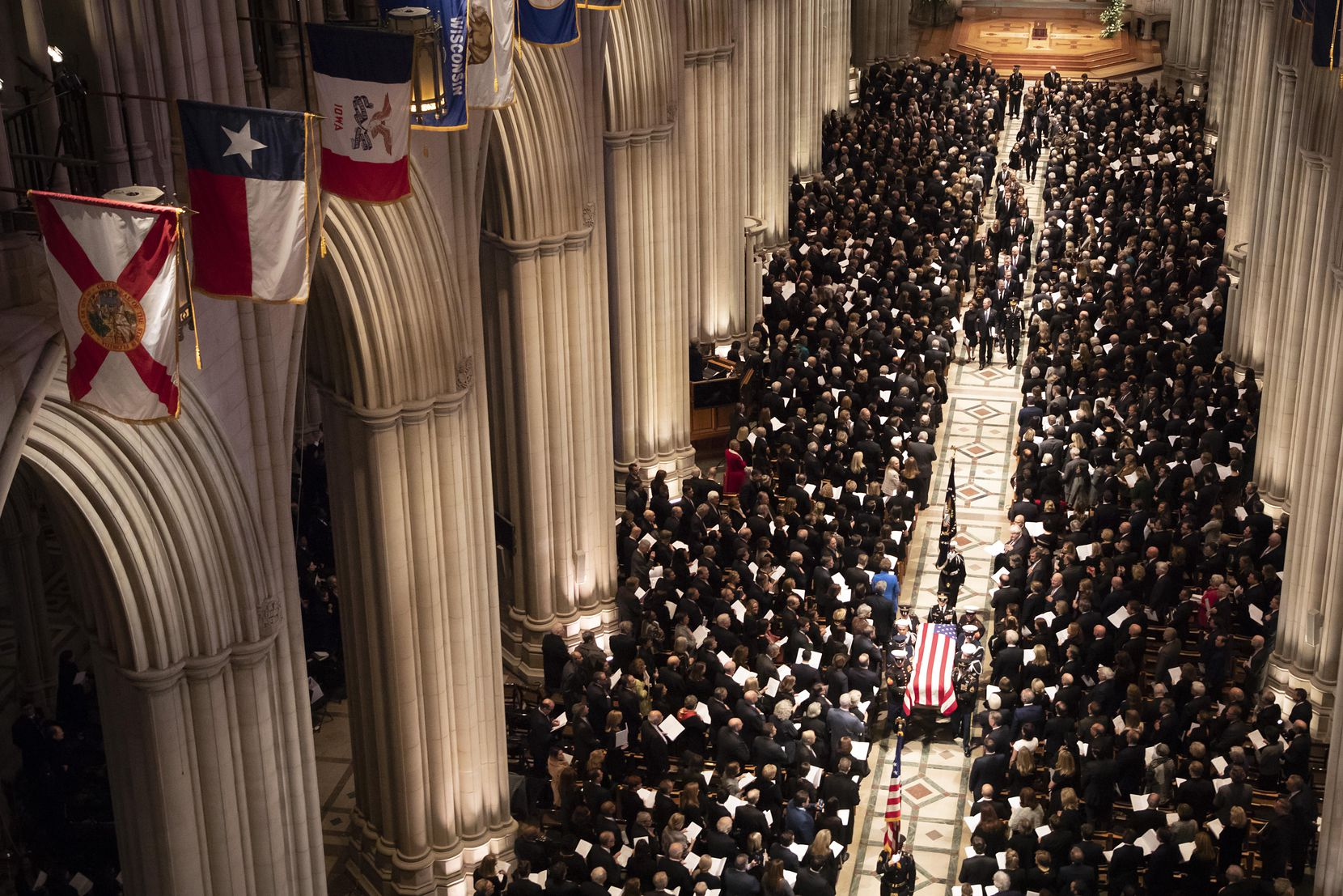 A military honor guard carries the flag-draped casket as it depart the Washington National Cathedral at the conclusion of the State Funeral for George H.W. Bush, the 41st President of the United States, on Wednesday, Dec. 5, 2018, in Washington. (Smiley N. Pool/The Dallas Morning News)