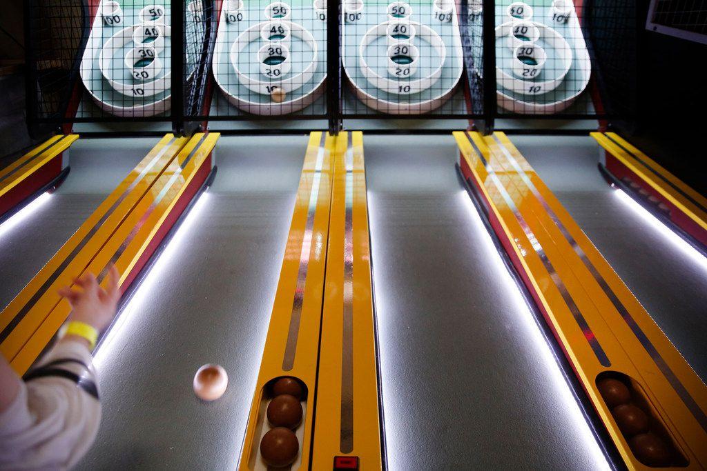 Jazmin Ruiz plays Skee-Ball at Cidercade in Dallas.