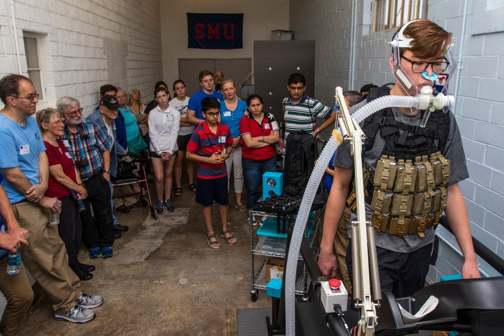 Joel Booth, an undergraduate research assistant, demonstrates a breathing task during Science in the City at Southern Methodist University in Dallas in 2018. The machine was measuring the difference between the inspired and expired air to calculate his energy expenditure.
