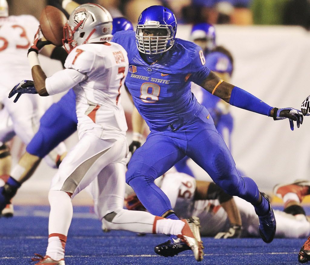 Boise State defensive end Demarcus Lawrence (8) eyes New Mexico running back Teriyon Gipson (7) during an NCAA college football game Saturday, Nov. 30, 2013, in Boise, Idaho. (AP Photo/The Times-News, Drew Nash) MANDATORY CREDIT ORG XMIT: IDTWF303 05212014xBRIEFING