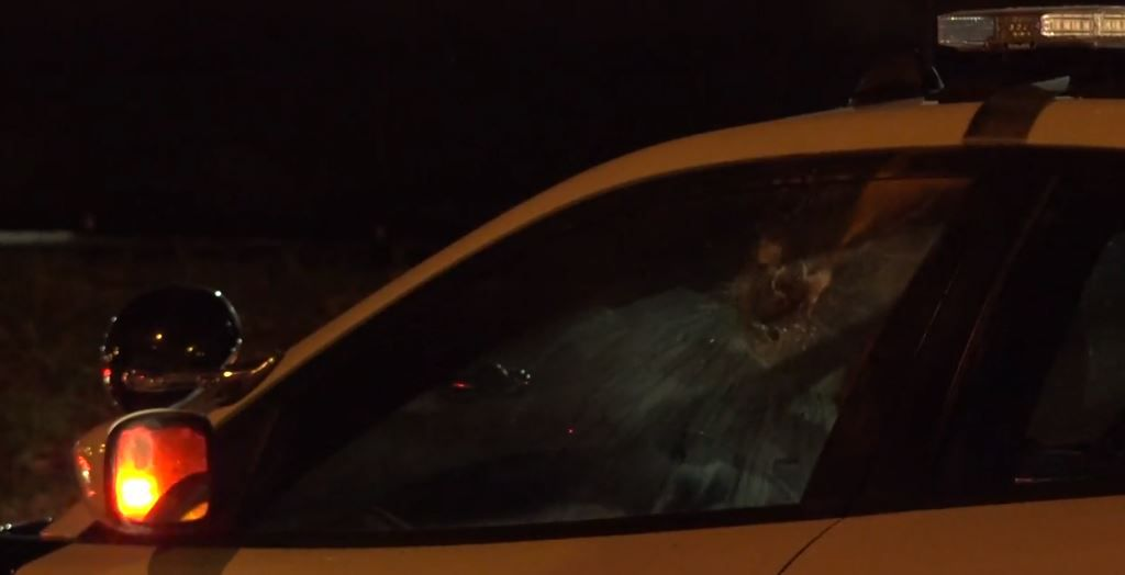 A Dallas police squad car's driver's-side window was damaged by fireworks Thursday night in east Oak Cliff.