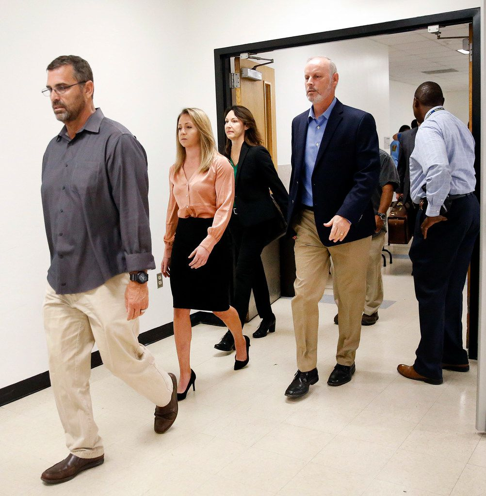 Along with her team, fired Dallas police Officer Amber Guyger (second from left) arrived for jury selection in her murder trial at the Frank Crowley Courthouse in downtown Dallas on Friday.