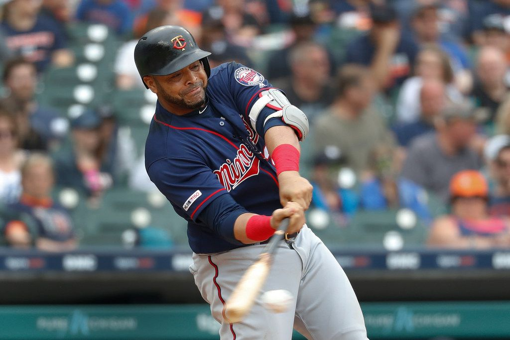 Minnesota Twins designated hitter Nelson Cruz hits a single in the fifth inning of a baseball game against the Detroit Tigers in Detroit, Sunday, June 9, 2019. (AP Photo/Paul Sancya)