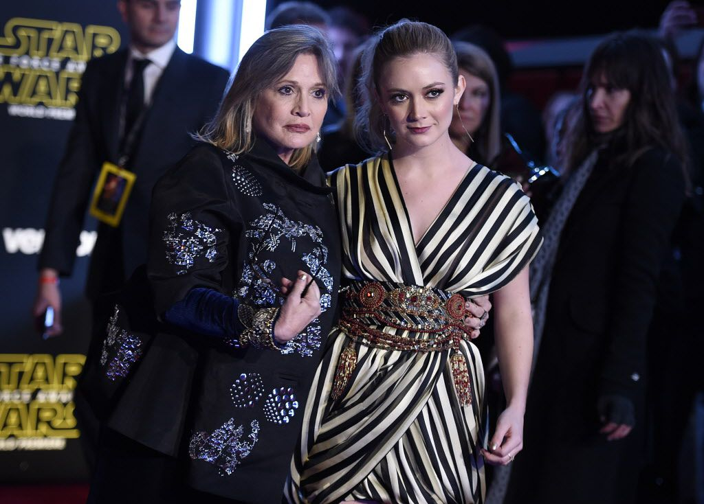 """Carrie Fisher, left, and daughter Billie Lourd arrive at the world premiere of """"Star Wars: The Force Awakens"""" at the TCL Chinese Theatre on Monday, Dec. 14, 2015, in Los Angeles."""