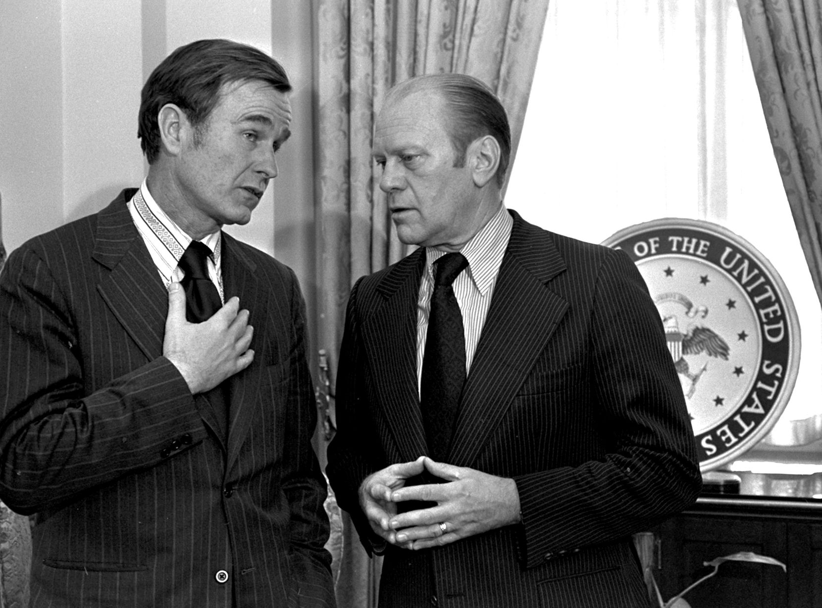 Republican National Chairman George H.W. Bush (left) chats with Vice President Gerald Ford in Washington in December 1973. Ford went on to pick up the pieces of Richard Nixon's scandal-shattered White House as the 38th and only unelected president in America's history.