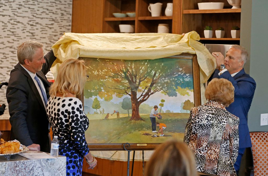Clark Hodges (right) and his brother Craig Hodges (left) unveil a painting that the Hodges family donated to the T. Boone Pickens Hospice and Palliative Care Center during a dedication ceremony in Dallas, Tuesday, April 18, 2017. Camille Hays (second from left) and Freddie Hdoges look on. (Jae S. Lee/The Dallas Morning News)