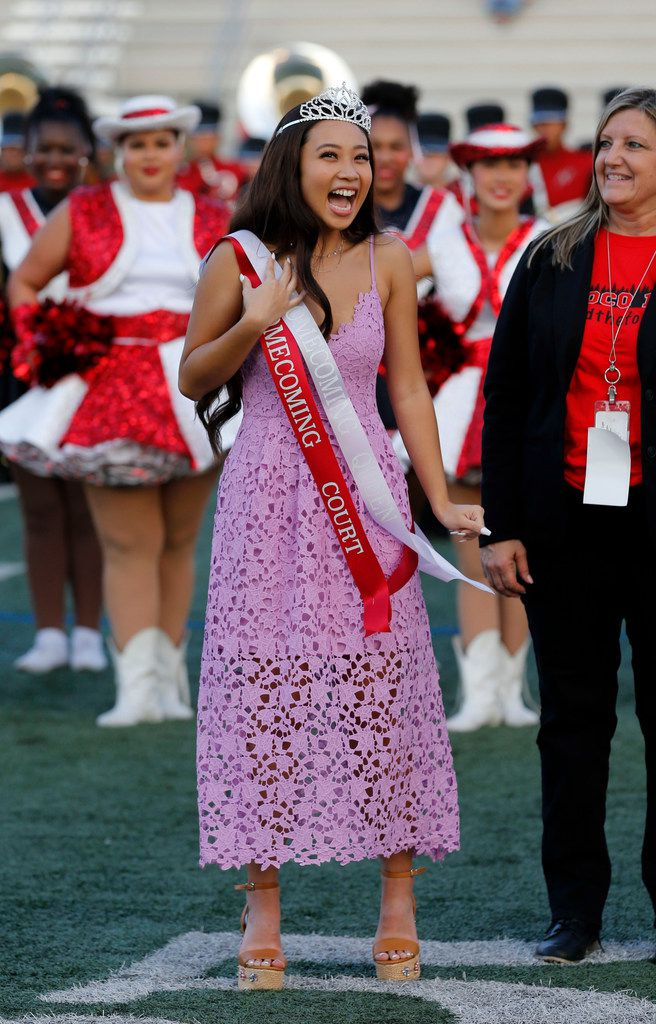North Garland's Tram Phan, a senior, reacts, after being named homecoming queen before the first half of the Garland Naaman Forest Vs. North Garland high school football game at Williams Stadium in Garland on Friday, October 4, 2019. (John F. Rhodes / Special Contributor)