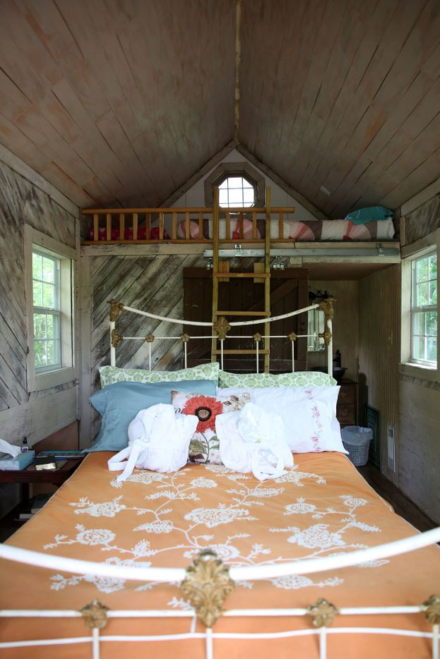 The second-story bedroom and loft in the Bare Creek Treehouse at Savannah's Meadow