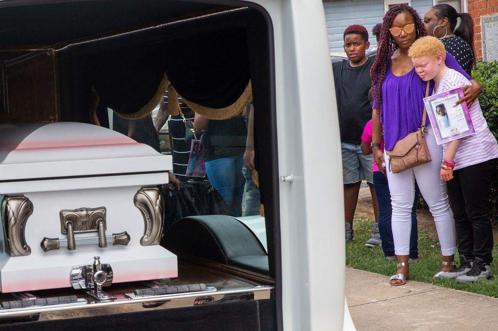 McKenzie Steward (right), 10, is comforted as the coffin of 9-year-old Brandoniya Bennett is transported following her funeral service Aug. 23 at the New Morning Star Missionary Baptist Church. Brandoniya was shot and killed when a gang member trying to kill a rival mistakenly fired shots into her Old East Dallas apartment.